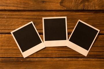 Instant photos on wooden floor
