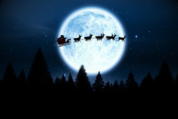 Santa flying over night sky