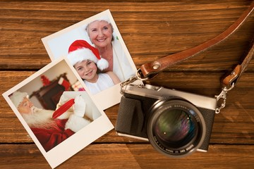 Instant christmas pictures on wooden table