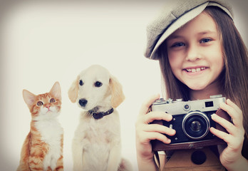 child photographer and kitten and puppy