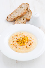 corn soup in plate and bread vertical