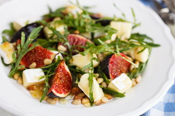 Salad with figs, pine nuts,Camembert Cheese and honey.