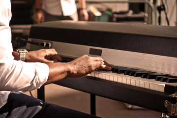 black piano player at the concert