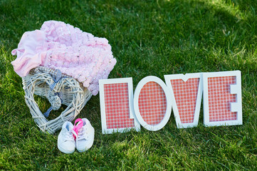 beautiful decor for a newborn on talbe, wooden letters love