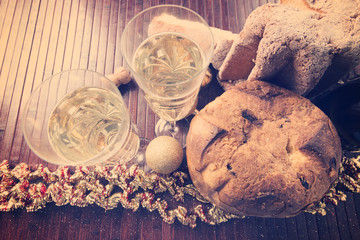 background with Pandoro and panettone and a bottle of prosecco wine seen from above with vintage style