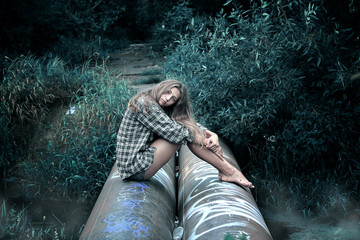 Girl in shirt sitting on the tubes