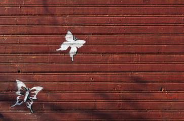 Butterflies on wooden wall