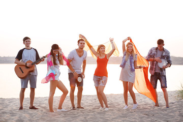 Carefree friends have fun on the beach