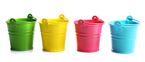 Four buckets of different colours, isolated on white Wall mural