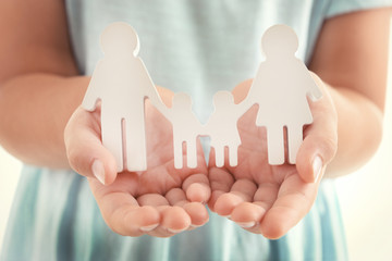 Concept of united family - figures of parents and kids in girls hands