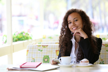 Beautiful business woman has lunch in the restaurant