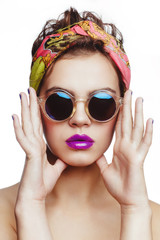 Beautiful charming attractive brunette model wearing bandana on her head and sunglasses, nude makeup, purple lips.