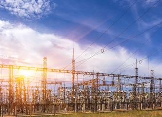 electric substation with power lines, at sunset