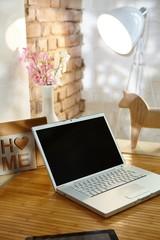 Laptop in trendy retro home
