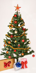 Christmas tree, decorated on white background, vertical image