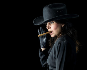 Woman in Black Cowboy Hat with Cigar
