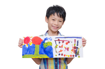 Little Asian boy showing his painting on paper