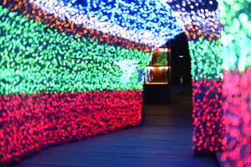 De-focused Christmas Light-colored walkway tunnel.