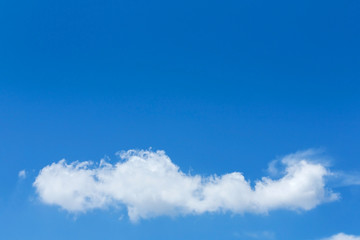 single cloud on clear blue sky background
