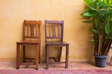 wooden chair and cement mortar wall background