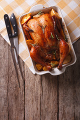 baked chicken with apples in the baking dish. vertical top view