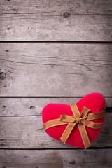 Decorative  red heart on  vintage wooden  background.