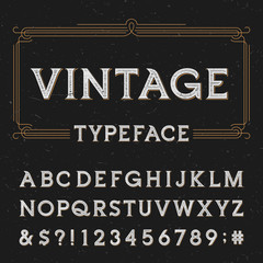 Vintage vector typeface. Type letters, numbers and symbols on a dark distressed background. Alphabet font for labels, headlines, posters etc.