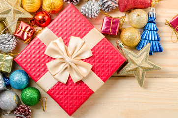 Red gift box and christmas decorations.