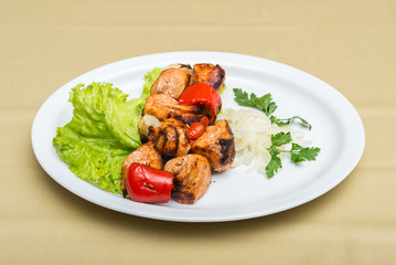 Dish of grilled meat and vegetables