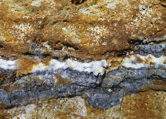 Detail of hydrothermal sphalerite (zinc ore) and drusy quartz vein in sandstone.