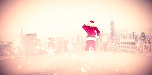 Composite image of santa scratching his head