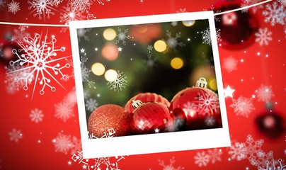 Composite image of focus on red christmas baubles