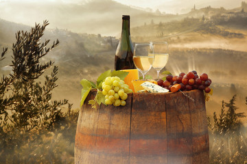 Wall Mural - White wine with barrel on vineyard in Chianti, Tuscany, Italy
