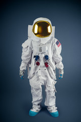 Astronaut standing on a grey background