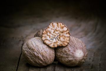 Nutmeg on an old wooden table