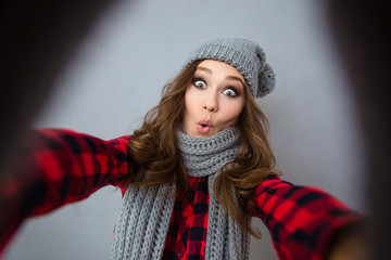 Funny woman making selfie photo