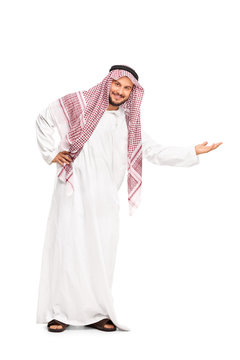 Arab in a white robe gesturing with his hand