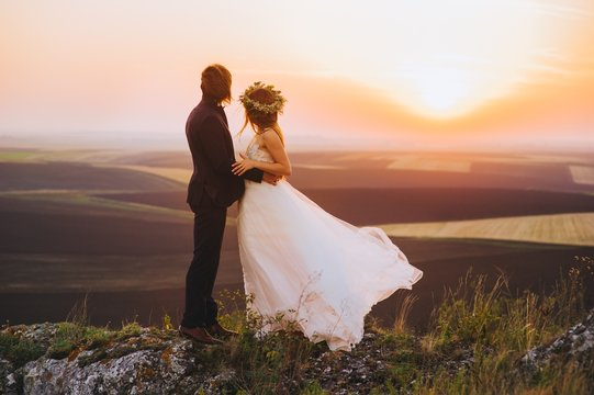 Wedding couple in the evening. Peaceful romantic moment.