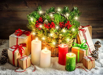 Christmas decoration burning candles and gift boxes lights