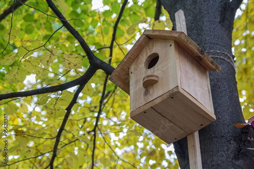 wooden birdhouse on the avenue autumn park imagens e fotos de stock royalty free no fotolia. Black Bedroom Furniture Sets. Home Design Ideas