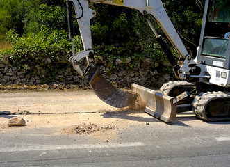 Mini excavator dig a trench with a bucket micro very tight