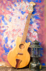 guitar still life with old lantern