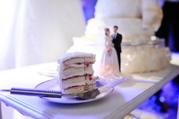 a piece of wedding cake at a wedding table