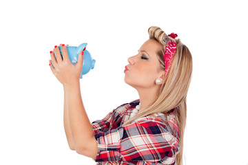 Cute girl kissing a money box in pinup style