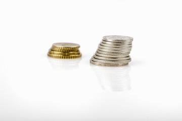 business, finance, investment, saving and cash concept - close up of euro coins on table