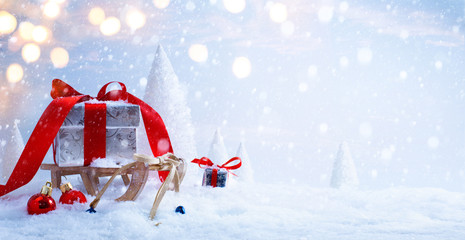 art Santa's sleigh with Christmas gifts on the background of sno