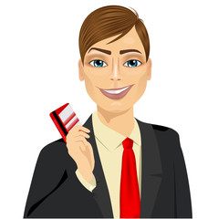 businessman with glasses holding a red credit card