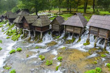 Spoed Fotobehang Molens Old wooden water mills, Jajce in Bosnia and Herzegovina