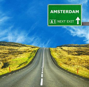 AMSTERDAM against clear blue sky