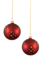 Two red Christmas balls or baubles with gold snowflake pattern isolated on white background